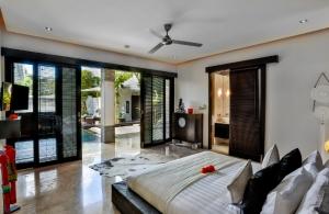 The Residence Seminyak - Villa Amala - Bedroom one view to pool